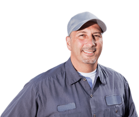 Company Truck Driver smiling in hat and work clothes.