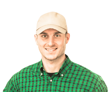 Student Truck Driver smiling in green plaid shirt and hat